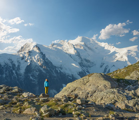 Woman admiring the beautiful mountain scenery in Mont Blanc massif