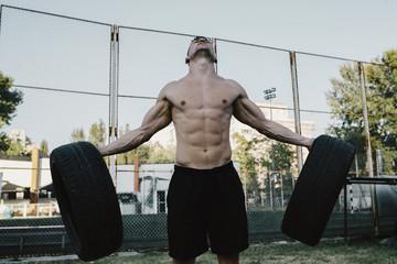 Sports man doing a workout outdoors