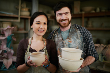 Proud potters family in small ceramics shop