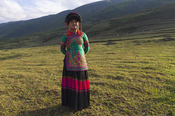 Beautiful Chinese Yi people in traditional costumes  outdoor