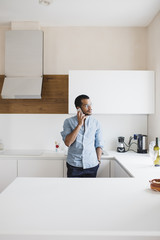 Young man calling with his cellphone