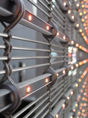 Illuminated shut-off lattice roller shutter with lights metal lamellar decorative separation futuristic look
