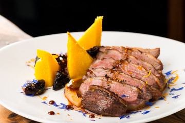 Duck breasts with sour plum - mango sauce, sweet potatoes and lotus