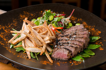 Lemongrass grilled beef steak with snow peas and taro potatoes
