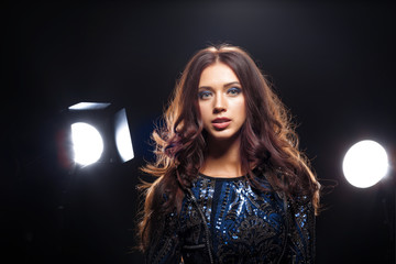 model in dress posing in front of camera