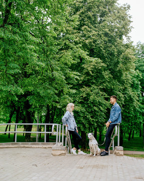 Couple with dog on step