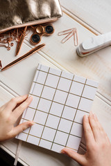 rose gold stationery tabletop, diary with hands