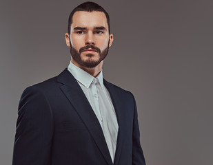 Studio portrait of a brutal bearded businessman wearing a formal