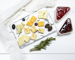 small pieces of brie cheese, roquefort, camembert, cheddar