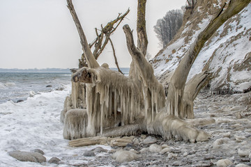 Magic isc sculptures at the beach , on a frosty winter day. - Frozen Ocean ice formations at the Baltic Sea