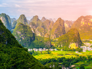 Fotobehang Lichtroze Panoramic view of landscape with karst peaks around Yangshuo County and Li River, Guangxi Province, China.