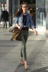 Confident woman walking on street