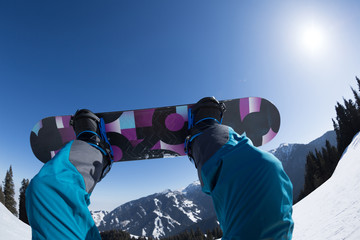 snowboarding legs on winter mountain  top