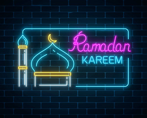 Glowing neon ramadan kareem greeting text with mosque dome and minaret in rectangle frame.