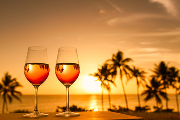 Romantic tropical getaway for two concept. Wine and a beautiful sunset.