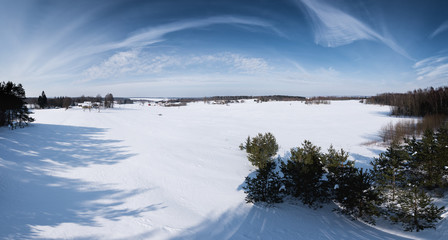 The panorama of snowy fields in Lithuania in winter time.