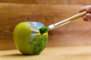 creative concept with green Apple