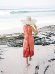Anonymous woman walking on sand