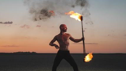 Man Fire Juggling In The Desert
