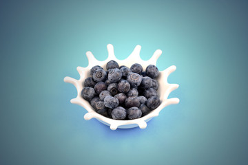 Blueberries stock images. Blueberries on a blue background. Blueberries in a white bowl