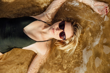 Blonde Woman Lays in Water