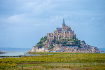Amazing Mont Saint Michel cathedral on the island, Normandy, Northern France, Europe. Grey day
