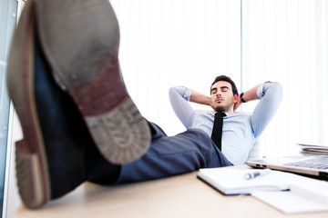 Young businessman sleeps in office