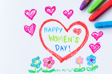Pencil color drawing Happy Women's Day on white paper with paper star. Womens Day concept.