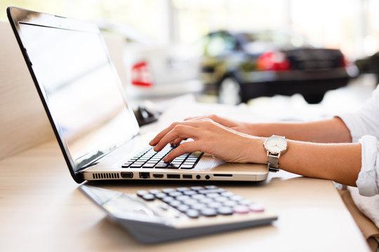 Car shop dealer working on financial documents