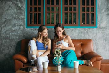 Friends Having Coffee in a Cafe