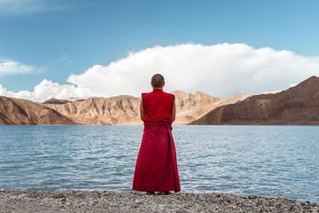 Buddhist monk from the back looking to the lake