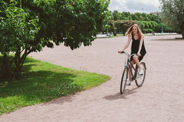 Young woman riding a bicycle in a park