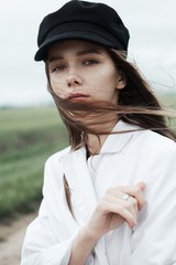 Portrait of a beautiful girl in a close-up hat