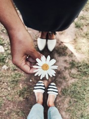 A friend giving a flower to a friend
