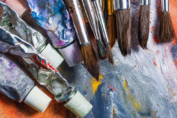 Artist paint brushes on wooden background