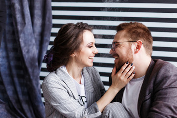 Beautiful couple hugging and talking. Deep feelings, love, affection. Close trusting relationship between a man and a woman. Close portrait in studio