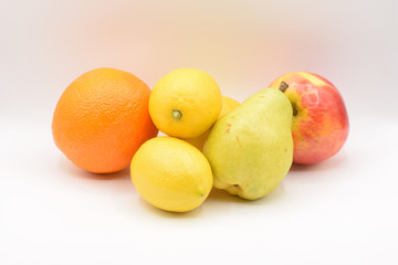 Citrus fruits arranged on a white background.