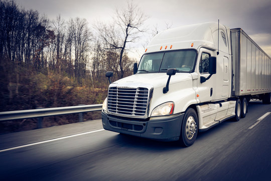 Semi truck 18 wheeler sleeper on highway