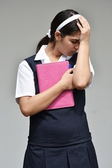 Unhappy Catholic Colombian Student Teenager School Girl Wearing School Uniform With Notebook