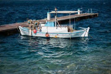 Little old fishing boat at sea
