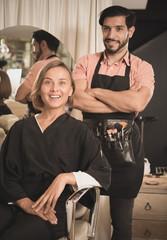 man makeup artist near client woman