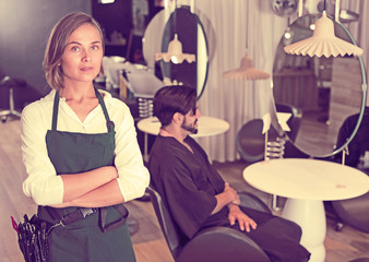 adult female hairdresser with male visitor