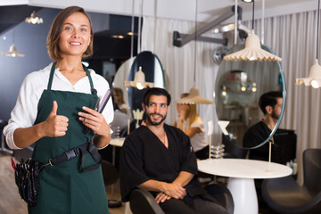 positive woman hairdresser thumbs up