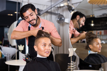 hairdresser working with woman hair