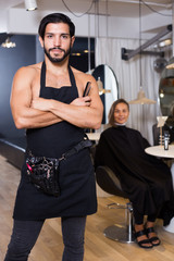 Portrait of sexy adlult male hairdresser standing
