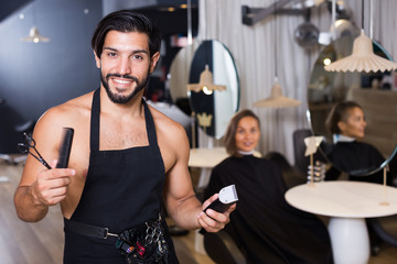 professional male hairdresser with visitor