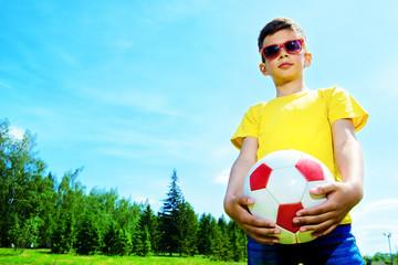 child boy plays football