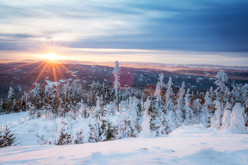 sunrise in snowy mountains