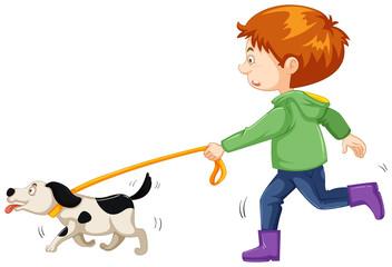 Little boy walking dog