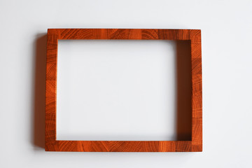 Save Download Preview Brown wooden frame for picture or photo on white background. Top view.